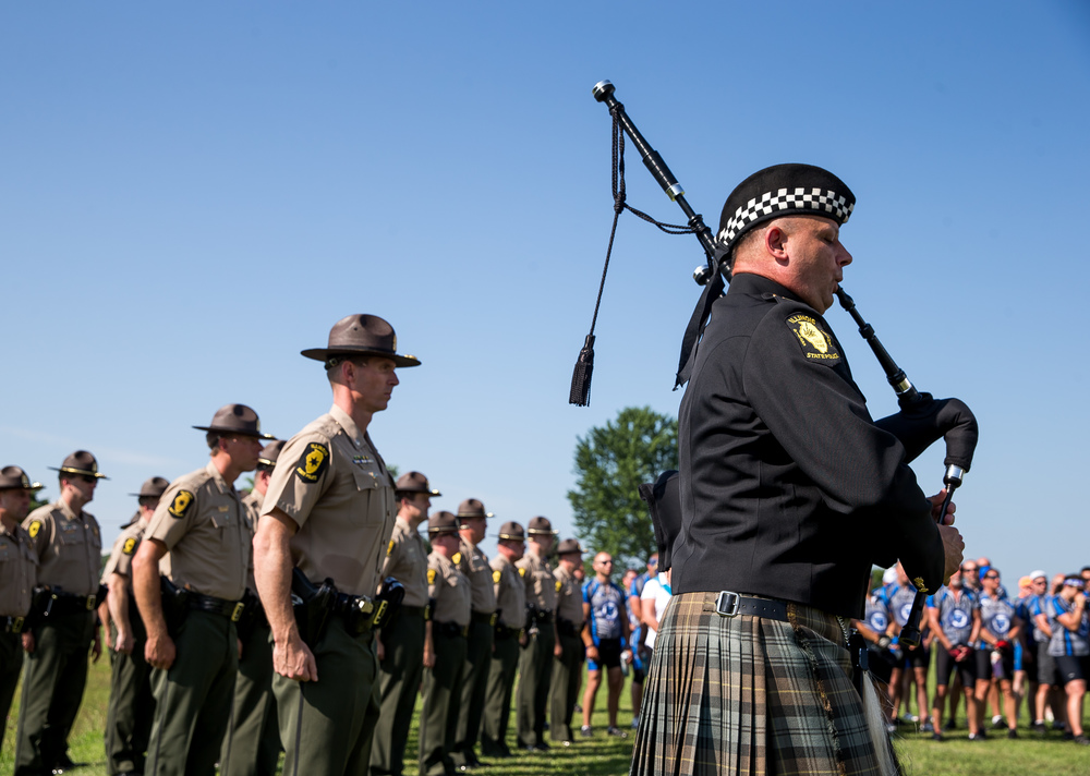 "Lt. Steven Riesenberg, of the Pipes and Drums Corps of the Illinois State Police, plays the bagpipes during a memorial ceremony for Trooper Bernard D. Skeeters, Friday, July 17, 2015, in Williamsville, Ill. The Stuttle Road overpass in Williamsville was renamed the ""Trooper Bernard D. Skeeters Memorial Overpass"" to honor the trooper killed when his patrol car was struck from behind by a tractor trailer on I-55 in 1982. Justin L. Fowler/The State Journal-Register"