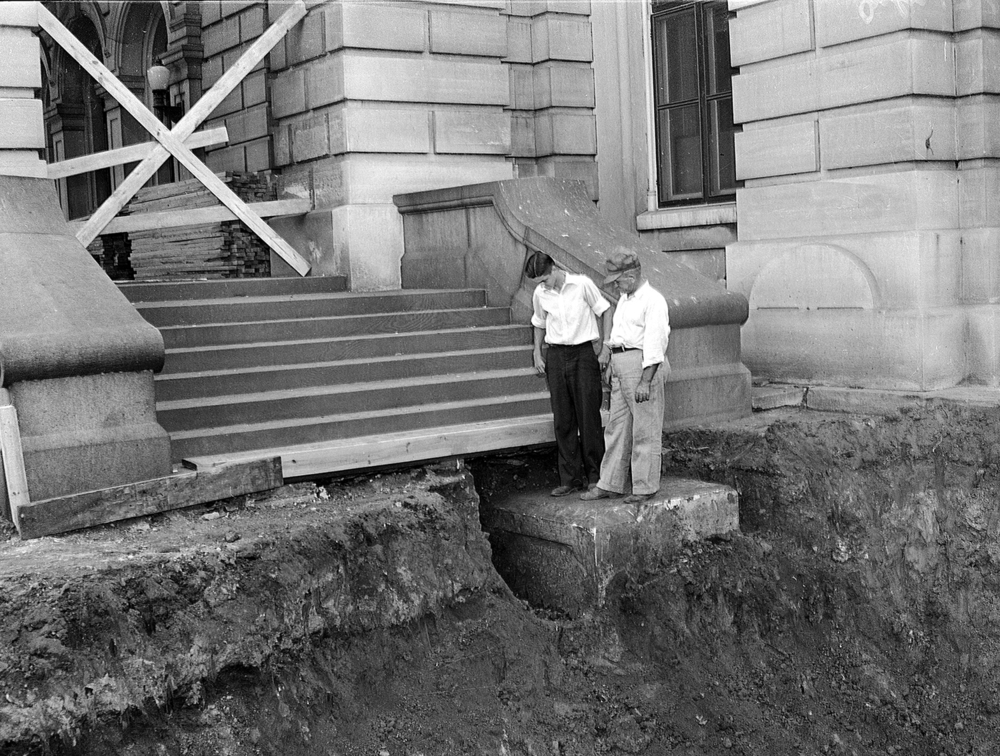 Workers examine the Capitol's orginal cornerstone July 17, 1944 after it was discovered under the steps on the east side. File/The State Journal-Register