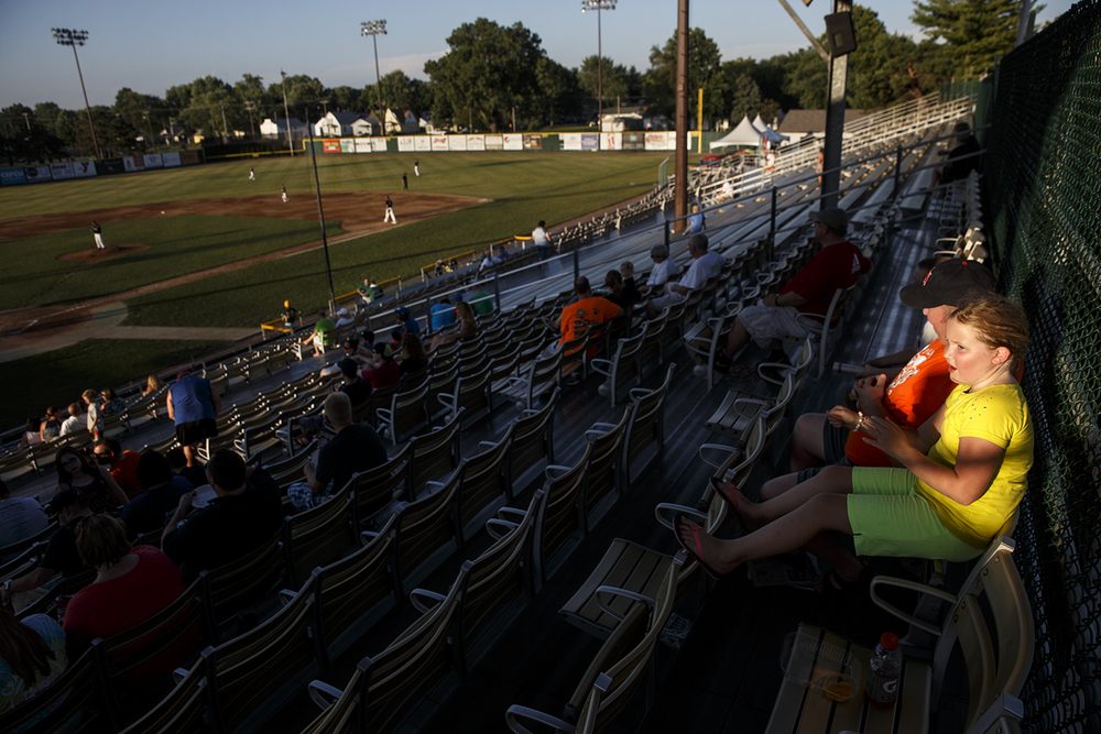 Halle Bandy takes in a Springfield Sliders game from the top of the bleachers with her dad Brian and brother Chris Friday, July 17, 2015. Ted Schurter/The State Journal-Register