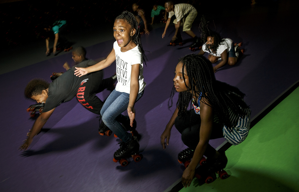 Kanisha Bolden can't stop fast enough to get on the floor when the music stopped during a game at Skateland South during a Camp Compass field trip Friday, July 10, 2015. Students at the camp, which recently received a $25,000 grant from State Farm, study to maintain and improve academic skills in the morning and spend  afternoons on enrichment activities and a weekly field trip. Ted Schurter/The State Journal-Register