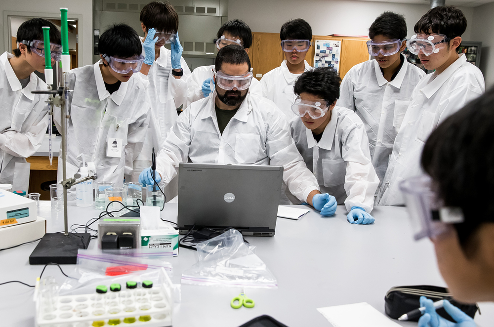 Nate Hoyle, a student at UIS pursuing his second degree and teacher's certification, helps students from Ashikaga, Japan, test water samples from various area locations during a Science Academy Program funded by the Japanese government at the University of Illinois Springfield, Monday, July 13, 2015, in Springfield, Ill. Justin L. Fowler/The State Journal-Register