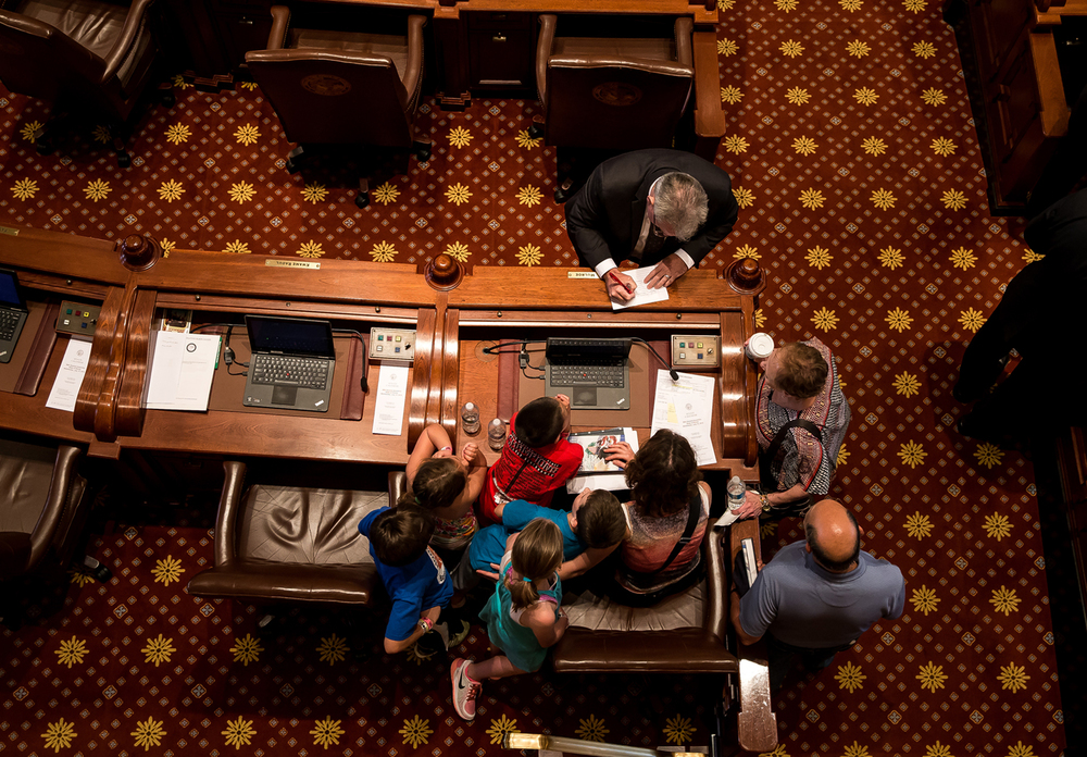 Visitors get an up close view of the desk of State Sen. John Mulroe, D-Chicago, prior to the Senate coming in to session at the Illinois State Capitol, Wednesday, July 15, 2015, in Springfield, Ill. Justin L. Fowler/The State Journal-Register