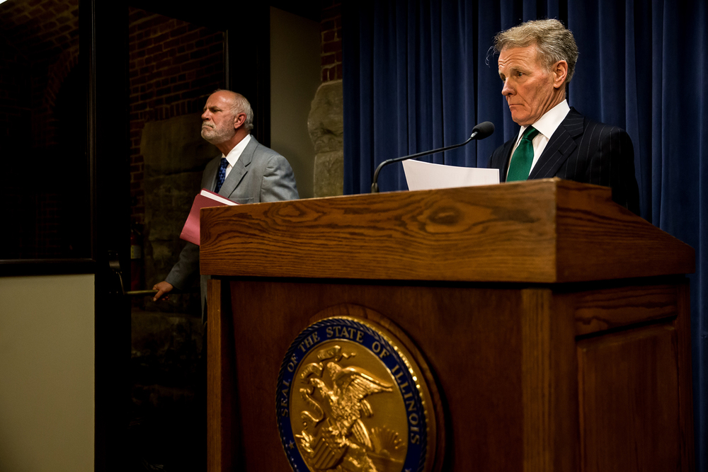 House Speaker Michael Madigan, D-Chicago, and Steve Brown, left, react as a question is asked at the end of a press conference at the Illinois State Capitol, Wednesday, July 15, 2015, in Springfield, Ill. Justin L. Fowler/The State Journal-Register