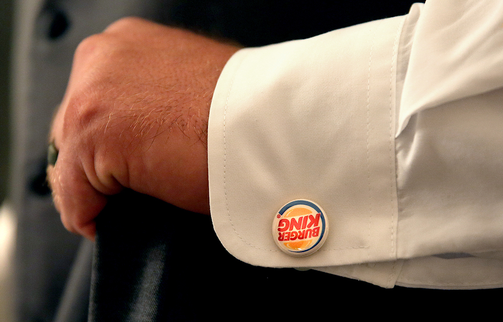 Joel Burger wore Burger King cuff links during his wedding with Ashley King July 17, 2015 in Jacksonville, Ill. The Burger King restaurant chain picked up the tab for the reception. David Spencer/The State Journal-Register