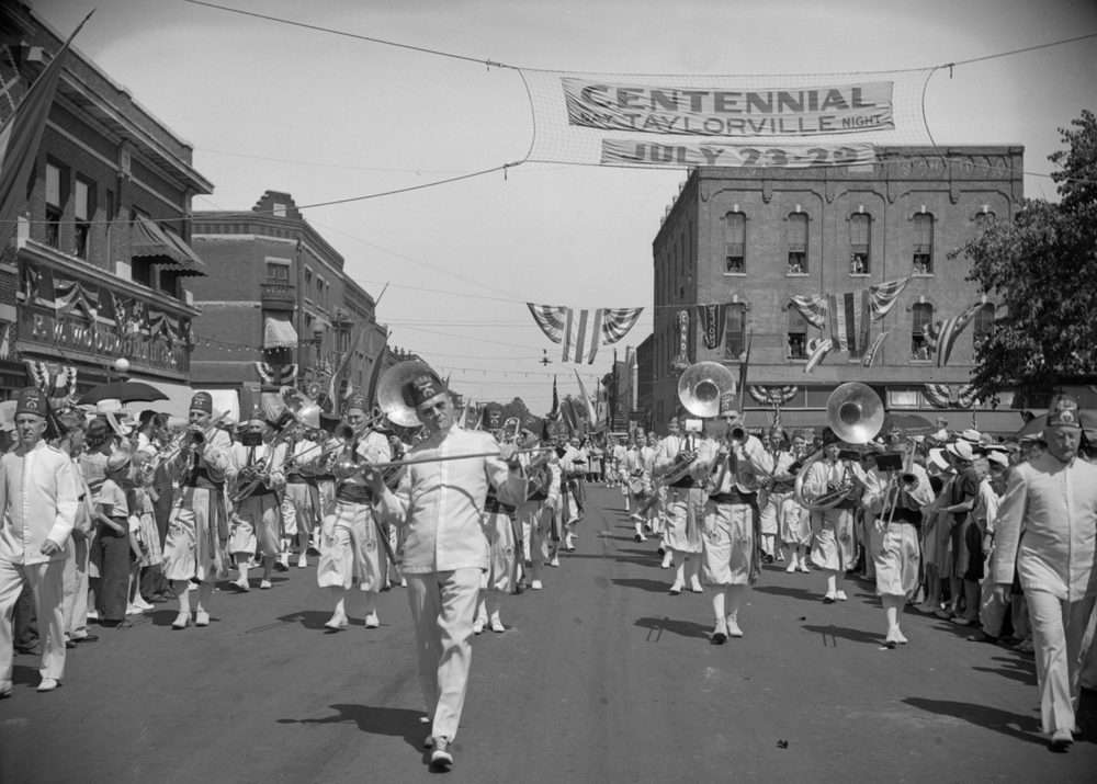 Ray Stout, drum major, leads the Springfield Ansar Shrine band in the Taylorville centennial celebration parade July 25, 1939. File/The State Journal-Register