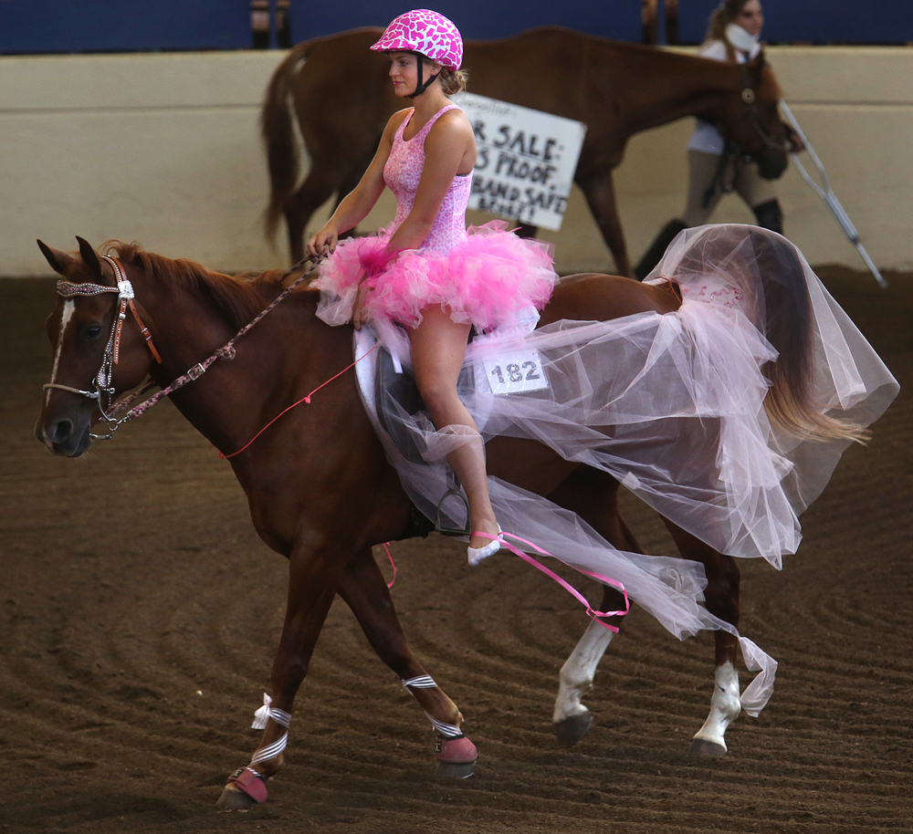 "RWF Special Effort ""Streak"" is dressed in a tutu along with ballerina rider Allison Smith of Kendall county. David Spencer/The State Journal-Register"