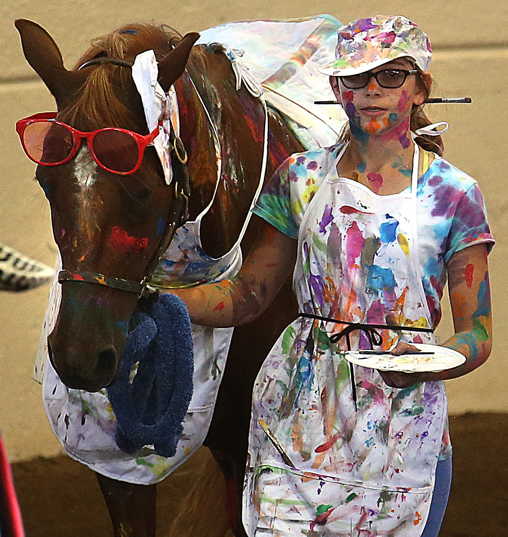 A messy artist indeed: Maya Baker of Peoria county, along with her horse Knead to Know (Scarlett) ,can't seem to keep the paint on the canvas. David Spencer/The State Journal-Register