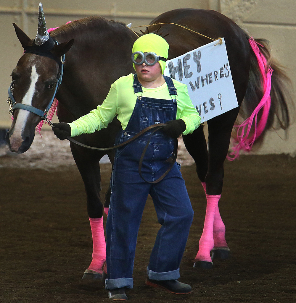 "Eric Wisely of Washington county and his horse Rocky Rockit. The horse, who may have actually been a Unicorn, had a sign slung over its' back stating ""Hey Where's Agnes?"" David Spencer/The State Journal-Register"