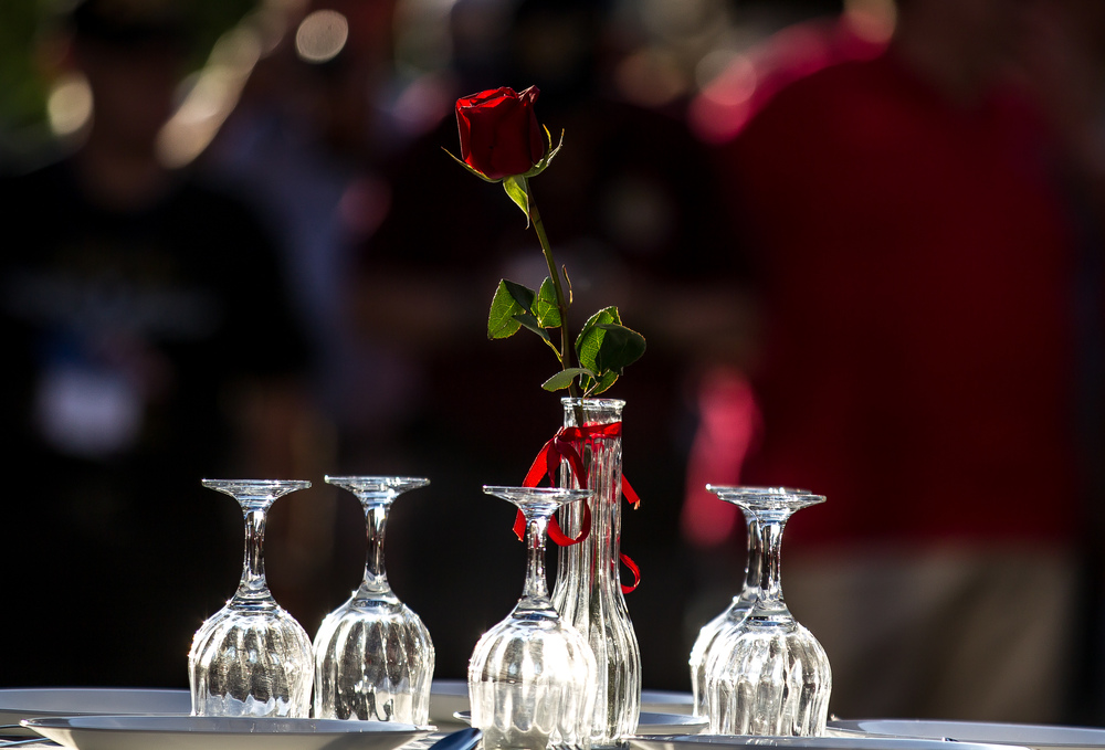 A single rose symbolizing the families and loved ones of the missing sits at the center of a Missing Man Table & Honors Ceremony during the Vietnam Veterans of America 2015 National Convention at the Hilton, Friday, July 24, 2015, in Springfield, Ill. Justin L. Fowler/The State Journal-Register