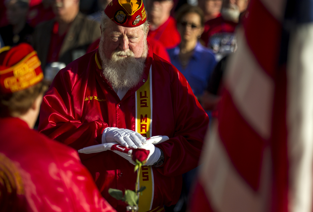 "Veteran Mike Malmstrom holds the flag of the U.S. Army as he represents that branch in the Missing Man Table & Honors ceremony but the Marine Corps League during the POW/MIA Ceremony during the Vietnam Veterans of America 2015 National Convention at the Hilton, Friday, July 24, 2015, in Springfield, Ill. ""It's emotional...I started doing this table in 1997 and I still get tears in my eyes,"" said Malmstrom of the ceremony. Justin L. Fowler/The State Journal-Register"