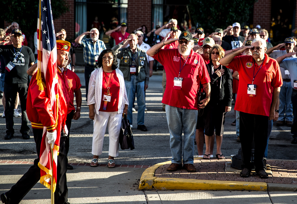 Vietnam veterans salute as the Marine Corp League presents the colors for the POW/MIA Ceremony during the Vietnam Veterans of America 2015 National Convention at the Hilton, Friday, July 24, 2015, in Springfield, Ill. Justin L. Fowler/The State Journal-Register