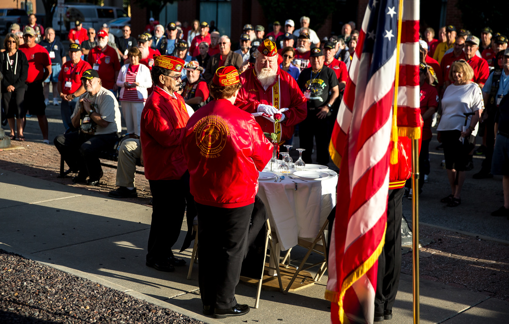 Members of the Marine Corp League, each holding a flag representing a branch of the military, stand over the Missing Man Table for the POW/MIA Ceremony during the Vietnam Veterans of America 2015 National Convention at the Hilton, Friday, July 24, 2015, in Springfield, Ill. Justin L. Fowler/The State Journal-Register