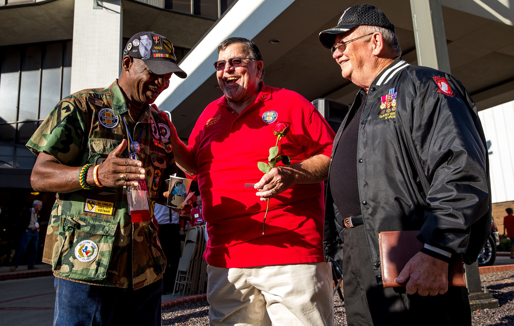 Vietnam veteran Paul Washington, left, of Houston, Texas, visits with former Vietnam POWs Bill Robinson, center, and Gary Sigler, right, during the POW/MIA Ceremony during the Vietnam Veterans of America 2015 National Convention at the Hilton, Friday, July 24, 2015, in Springfield, Ill. Justin L. Fowler/The State Journal-Register