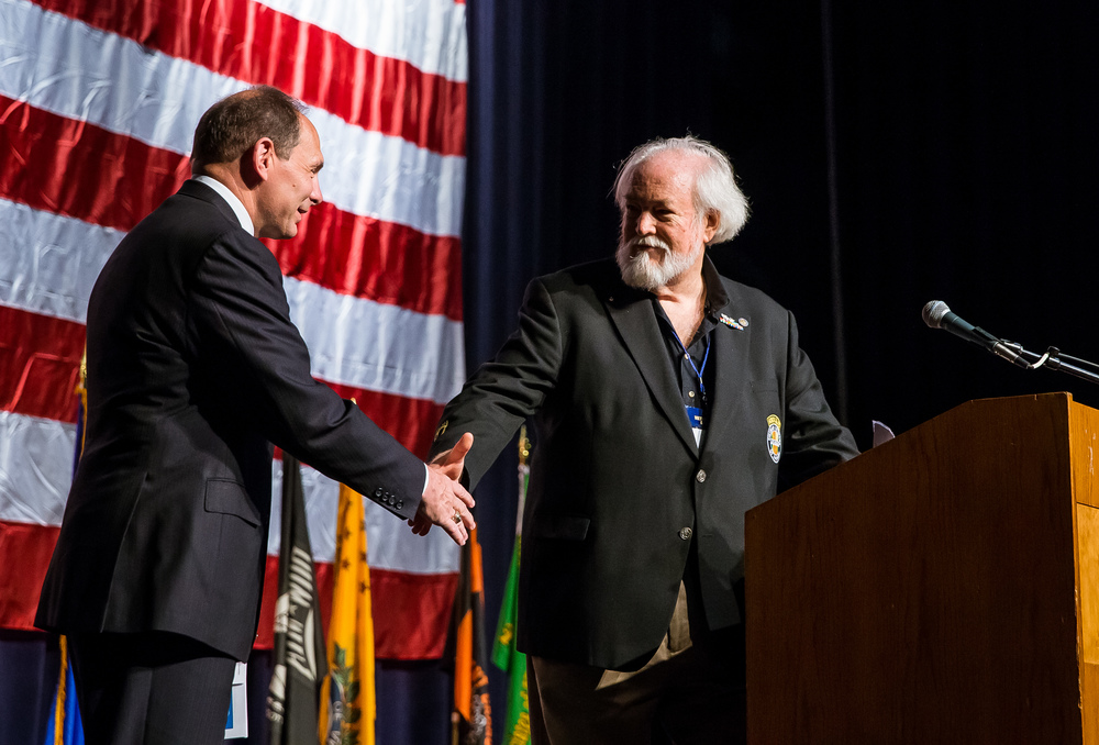 John Rowan, right, national president of the Vietnam Veterans of America, greets Veterans Affairs Secretary Robert McDonald as he makes his way to the podium to deliver his address during the Vietnam Veterans of America 2015 National Convention at the Prairie Capital Convention Center, Friday, July 24, 2015, in Springfield, Ill. Justin L. Fowler/The State Journal-Register