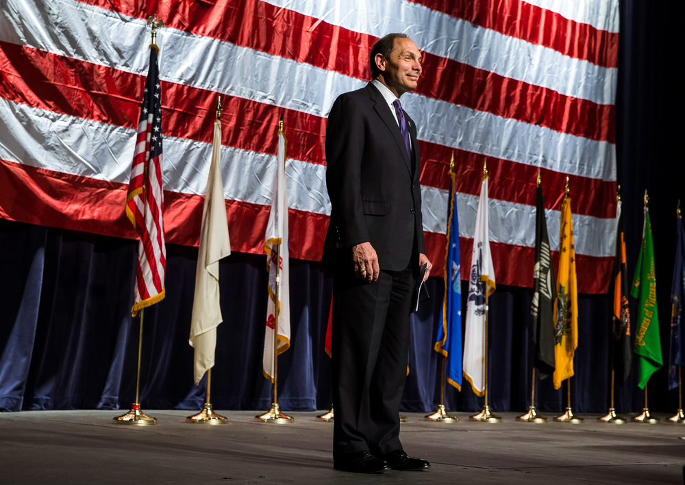 Veterans Affairs Secretary Robert McDonald walks out on stage to give his address during the Vietnam Veterans of America 2015 National Convention at the Prairie Capital Convention Center, Friday, July 24, 2015, in Springfield, Ill. Justin L. Fowler/The State Journal-Register