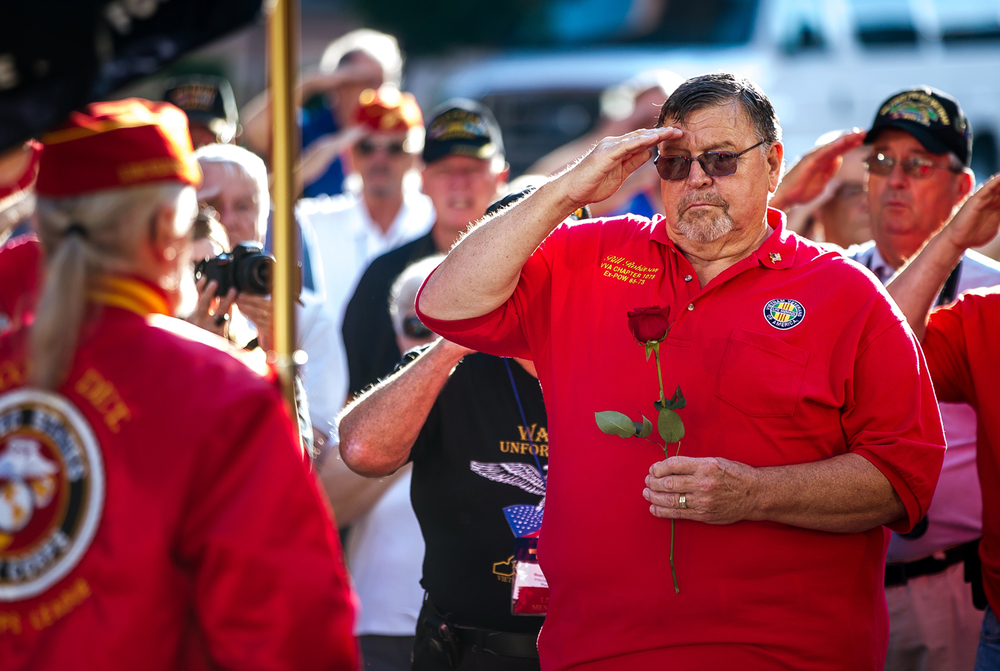 Airman Bill Robinson, the longest-held enlisted prisoner of war in American history, salutes as the colors are retired as he holds a rose symbolizing the families and loved ones of the missing for the POW/MIA Ceremony during the Vietnam Veterans of America 2015 National Convention at the Hilton, Friday, July 24, 2015, in Springfield, Ill. Justin L. Fowler/The State Journal-Register