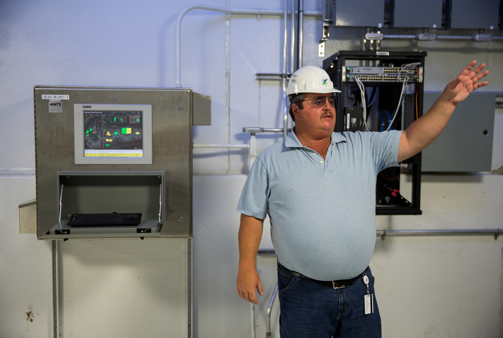Brian Tucker, operations supervisor at the Springfield Metro Sanitary District, shows one of the control panels that allow operators to run systems across the plant from various locations at the Springfield Metro Sanitary District's Spring Creek wastewater treatment plant, Friday, July 31, 2015, in Springfield, Ill. Justin L. Fowler/The State Journal-Register