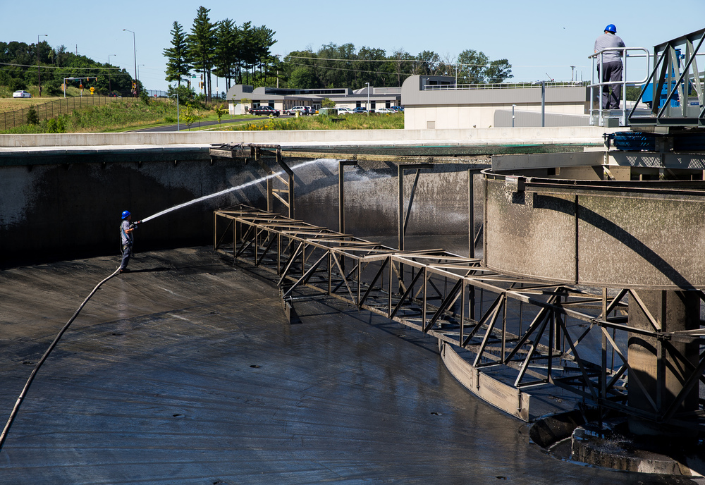A maintenance crew sprays down the skimmers in a primary clarifier that is down for maintenance at the Springfield Metro Sanitary District's Spring Creek wastewater treatment plant, Friday, July 31, 2015, in Springfield, Ill. Justin L. Fowler/The State Journal-Register