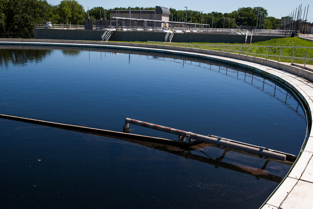 A skimmer removes the remaining material or microorganisms left behind as the water enters the secondary clarifier at the Springfield Metro Sanitary District's Spring Creek wastewater treatment plant, Friday, July 31, 2015, in Springfield, Ill. Justin L. Fowler/The State Journal-Register