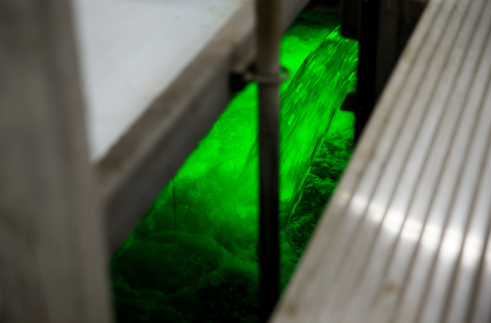 Wastewater flowing through the ultraviolet disinfection system is illuminated as it exits the process at the Springfield Metro Sanitary District's Spring Creek wastewater treatment plant, Friday, July 31, 2015, in Springfield, Ill. Justin L. Fowler/The State Journal-Register