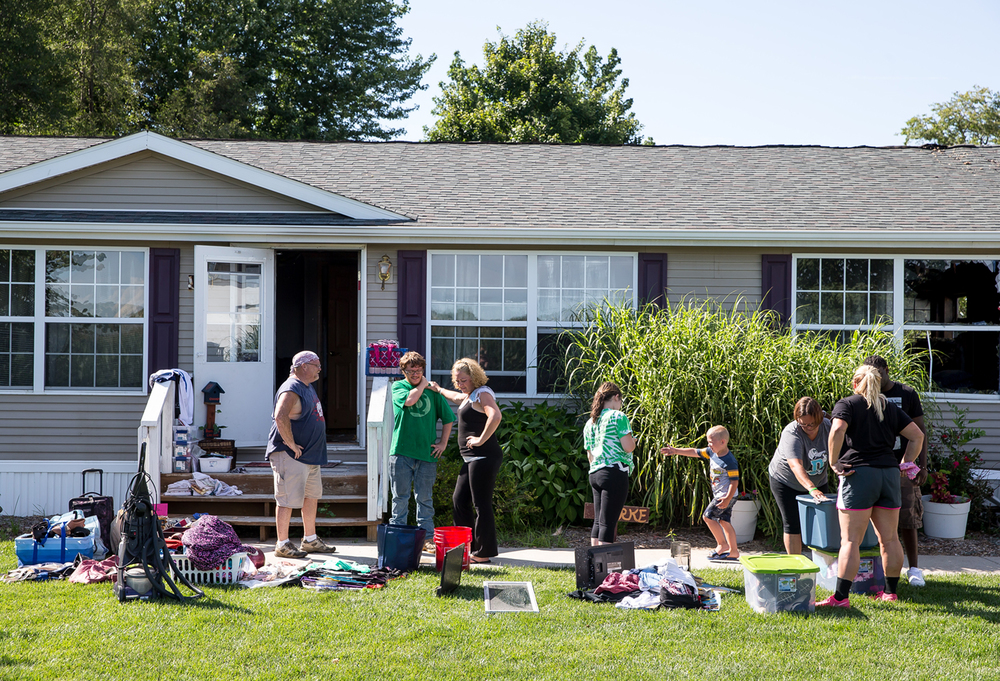 Family and friends gather at the home of Jessica and Lon Burke to help them salvage what possessions remain the day after a fire destroyed their home, Wednesday, July 29, 2015, in Curran, Ill. Justin L. Fowler/The State Journal-Register