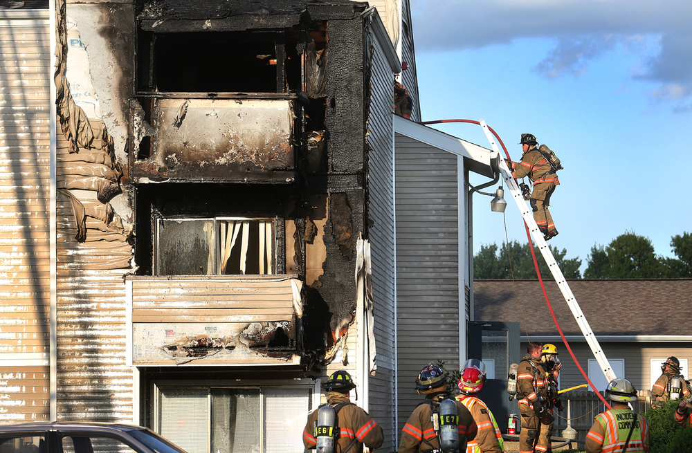 Two dozen residents were displaced but no one was injured by a fire at Chatham Hills Apartments Friday, July 31, 2015. Most of the damage was limited to three units at 10 Candlewood Dr. but others suffered smoke damage, according to the Springfield Fire Department. David Spencer/The State Journal-Register
