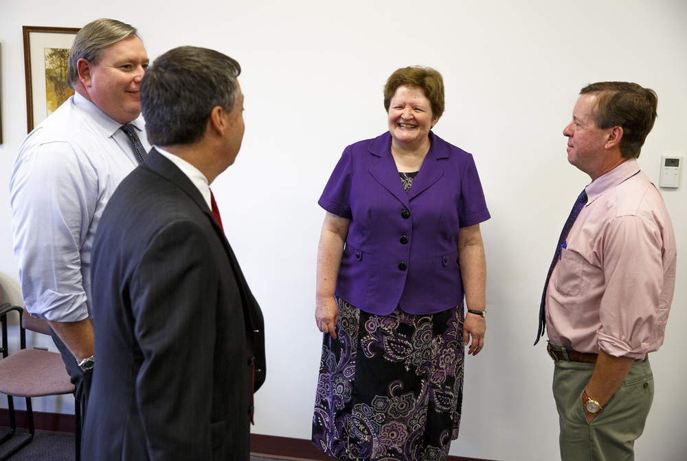 Sheryl Essenburg visits with Sangamon County circuit judges John Schmidt, left, John Belz and Pat Kelly during a reception in her honor Wednesday, July 29, 2015 at the Sangamon County building in Springfield, Ill. Essenburg retired after working 34 years in the Sangamon County States Attorney's office. Rich Saal/The State Journal-Register