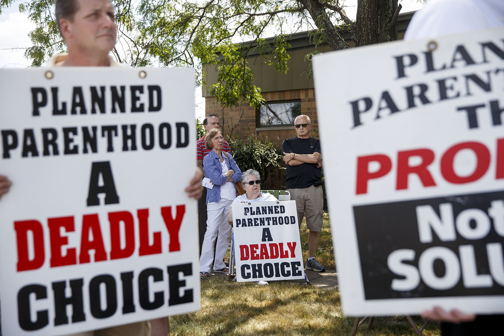 About 90 people, including Iris Tranquilli of Riverton, Il., gathered for a pro-life rally in front of Planned Parenthood's Springfield health center Thursday, Aug. 6, 2015. Ted Schurter/The State Journal-Register