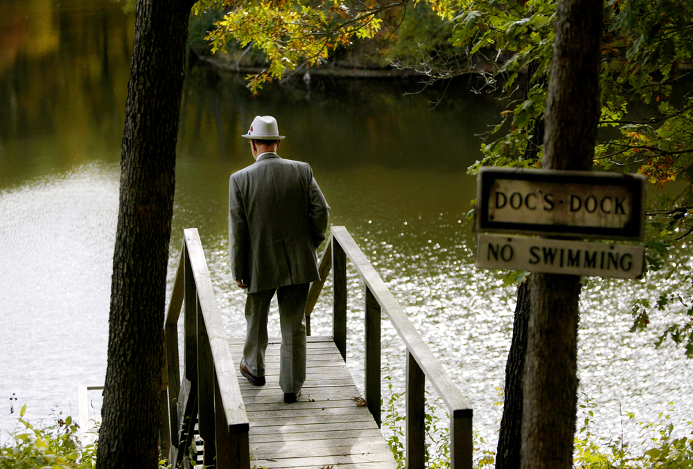 Dohner walks to the edge of his dock at his cabin near Rushville while checking on his property. Dohner rarely takes time off, but fishing with his best friend Bill Bartlow used to be a pastime he enjoyed. Even when he fished, he wore a tie in case he was called to work. Photo by Shannon Kirshner/The State Journal-Register