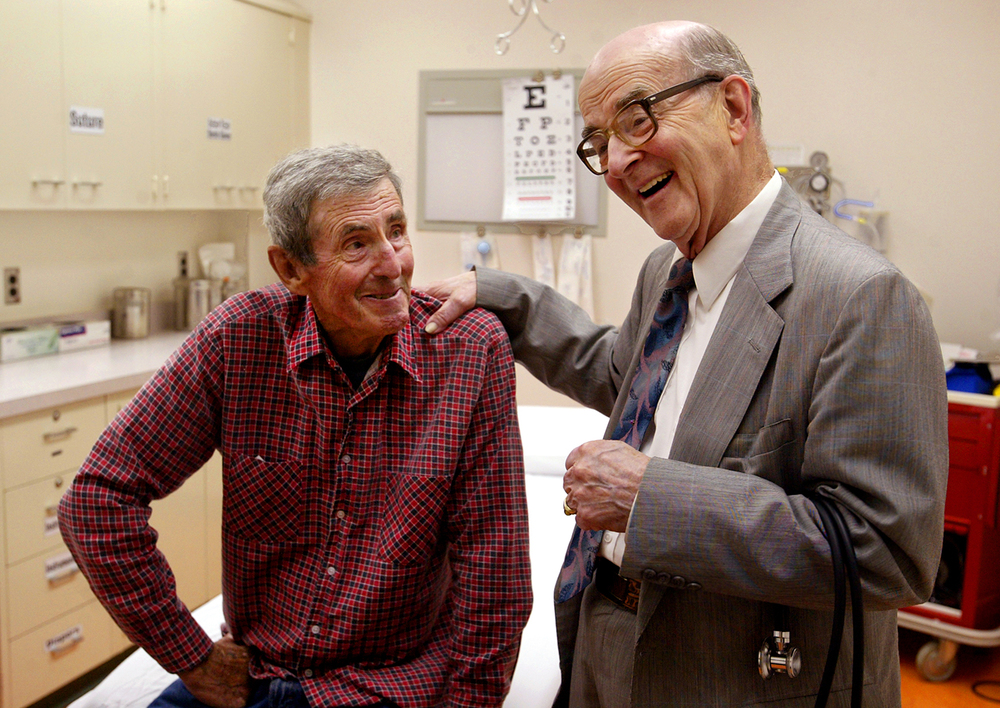 "Dohner comforts long-time patient George Hughes, 72, of Astoria, after Hughes was examined in the emergency room of Culbertson Memorial Hospital. ""(Being a doctor) has been such a mission for (Dr. Dohner) his whole life,"" said Dianne Snyder, a friend of Dohner's. ""It's a ministry for him."" Photo by Shannon Kirshner/The State Journal-Register"