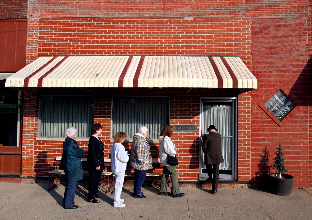 Dohner arrives at his private practice on the square in Rushville every Sunday morning at 9 a.m. where he sees patients until going to church at 10:15 a.m. It's hard for Dohner and his small staff to keep up with the constant stream of patients during a week. Last Friday (November 26, 2004), Dohner saw over 50 patients and didn't stop to eat lunch. Photos by Shannon Kirshner/The State Journal-Register