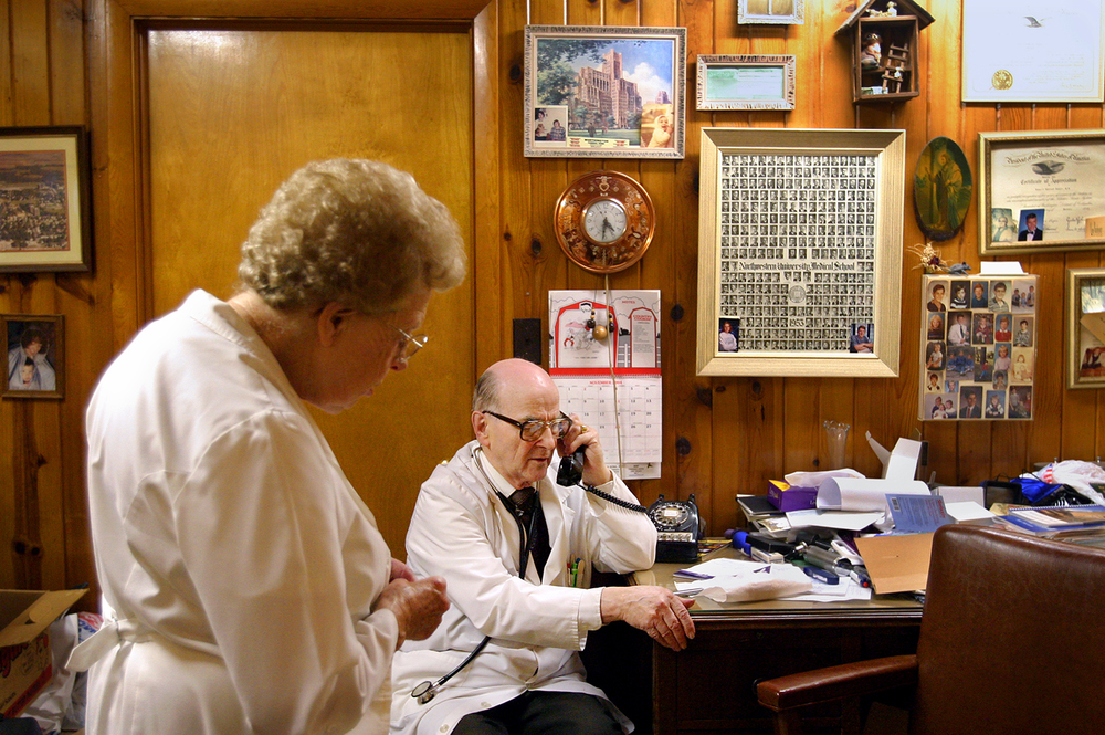 Dont leave her room till she smiles, Dr. Russell Dohner told a nurse over the phone who called to get his advice about a sick patient. Between examining patients at his office in Rushville with his loyal nurse, 81-year-old Florence Bottorf whos been Dohners nurse since 1958, Dohner fields calls. Photo by Shannon Kirshner/The State Journal-Register