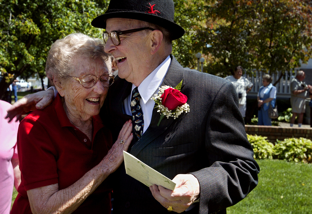 """Doctor Russell Dohner, 79, hugs patient Margaret Crum, 90, on the town square in Rushville during an all-day celebration of the Illinois state Senate proclamation that made August 22 Dr. Dohner Day in honor of Dohner's 50 years of service to the community. """"He's wonderful, that's all,"""" Crum said. Dohner has been Crum's family doctor for almost 40 years. Photo by Shannon Kirshner/The State Journal-Register"""