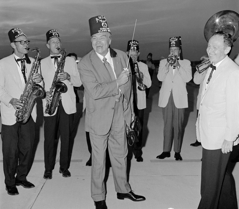 "Entertainer Red Skelton arrives at Springfield airport August 12, 1971 for show at Illinois State Fair. The Ansar Shrine Band greeted him. Band members are, from left, Lyle Dunham, Herman Hahn, unidentified, R.O. ""Scotty"" Meredith and director Sid Ackerman. File/The State Journal-Register
