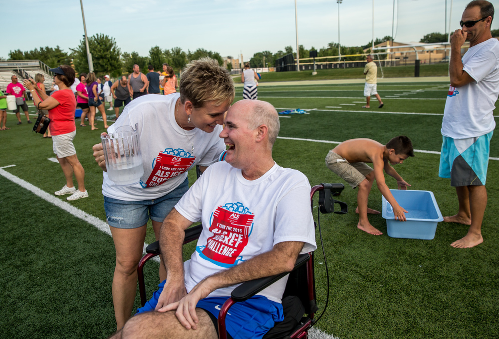 Tammie Rockford checks in with her husband, Steve, one last time to see if he really wants to do the ALS Ice Bucket Challenge as she holds a pitcher of ice water at the Sacred Heart-Griffin Sports Complex, Friday, Aug. 7, 2015, in Springfield, Ill. Justin L. Fowler/The State Journal-Register
