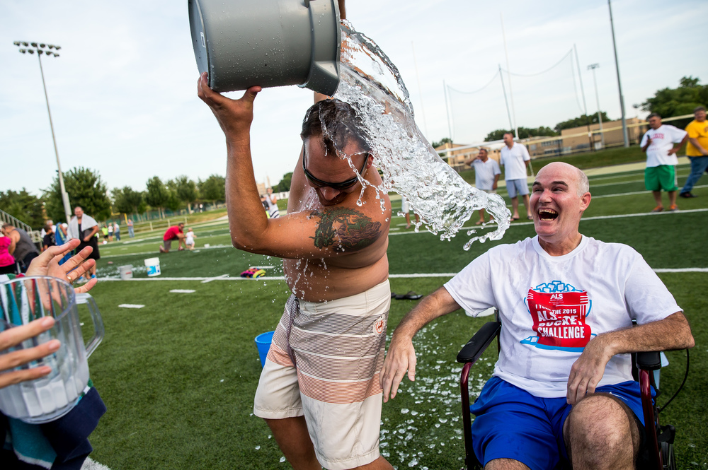 "Nick Faulkner, center, not only dumped ice water on himself, but he also included Steve Rockford, right, during a mass ALS Ice Bucket Challenge at the Sacred Heart-Griffin Sports Complex, Friday, Aug. 7, 2015, in Springfield, Ill. ""Steve's attitude and the way he has carried himself through the disease...it's an inspiration for everybody,"" said Faulkner. Justin L. Fowler/The State Journal-Register"