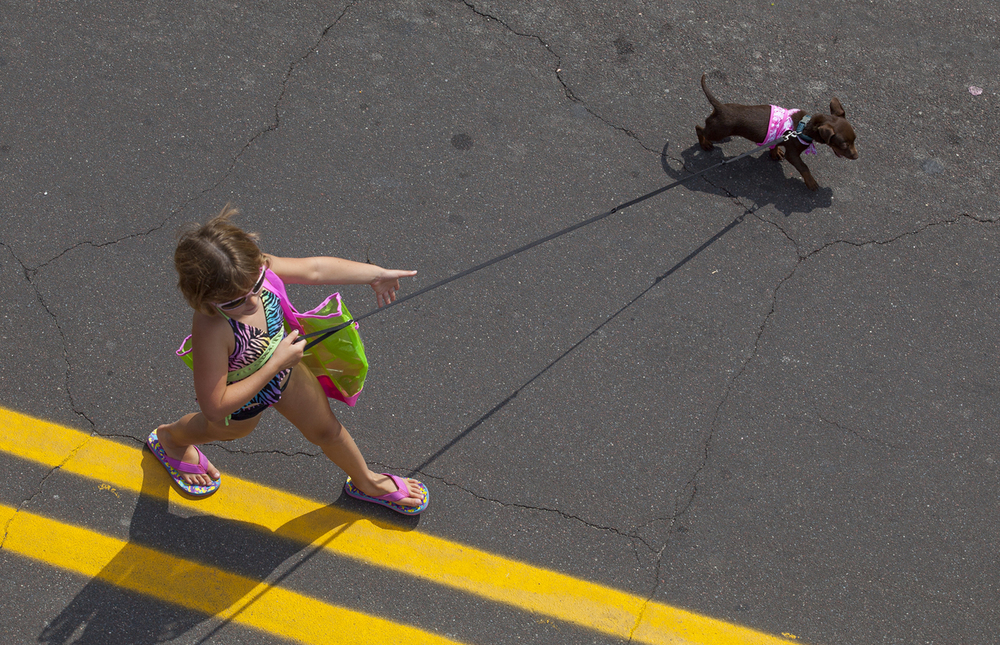 "A girl walks with her dog in the Hillsboro Old Settlers Days Kiddie Parade Thursday, Aug. 6, 2015. The theme of this year's parade was ""Storybooks Come to Life."" Rich Saal/The State Journal-Register"
