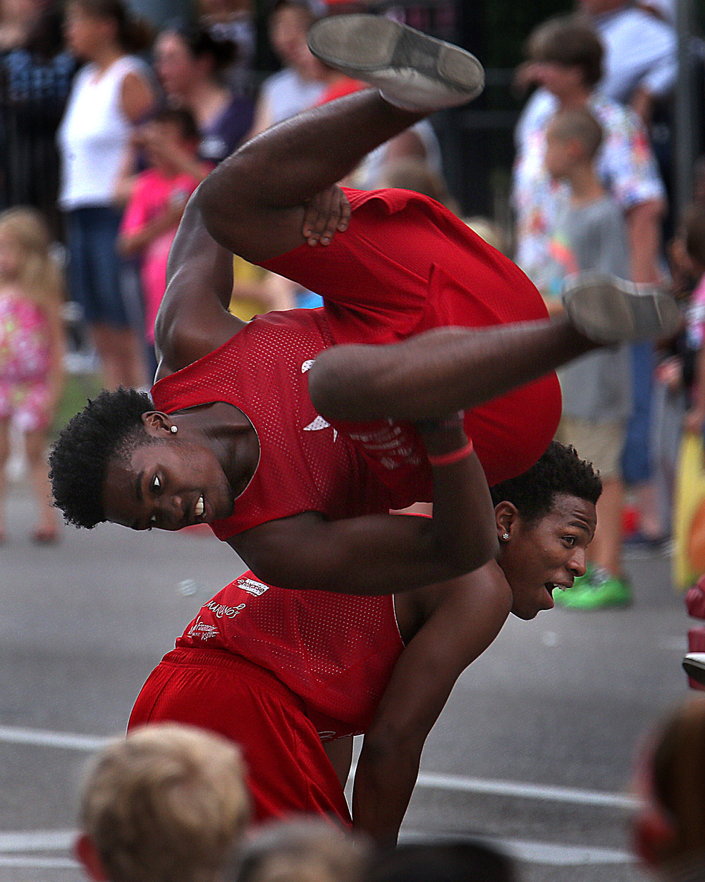 Members of the Jesse White Tumblers perform along the parade route. David Spencer/The State Journal-Register