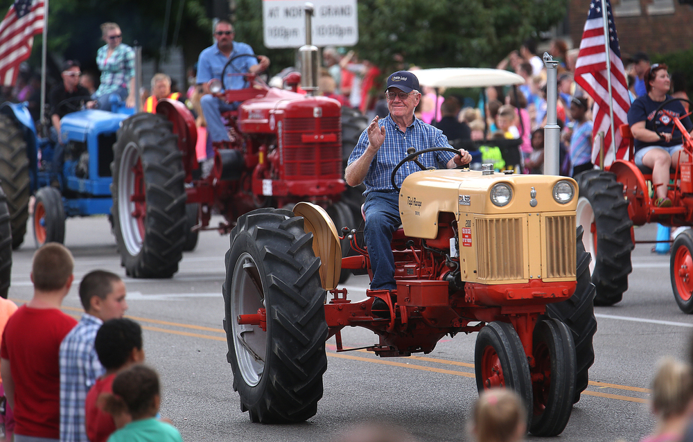 A convoy of antique farm tractors took part in the parade. David Spencer/The State Journal-Register