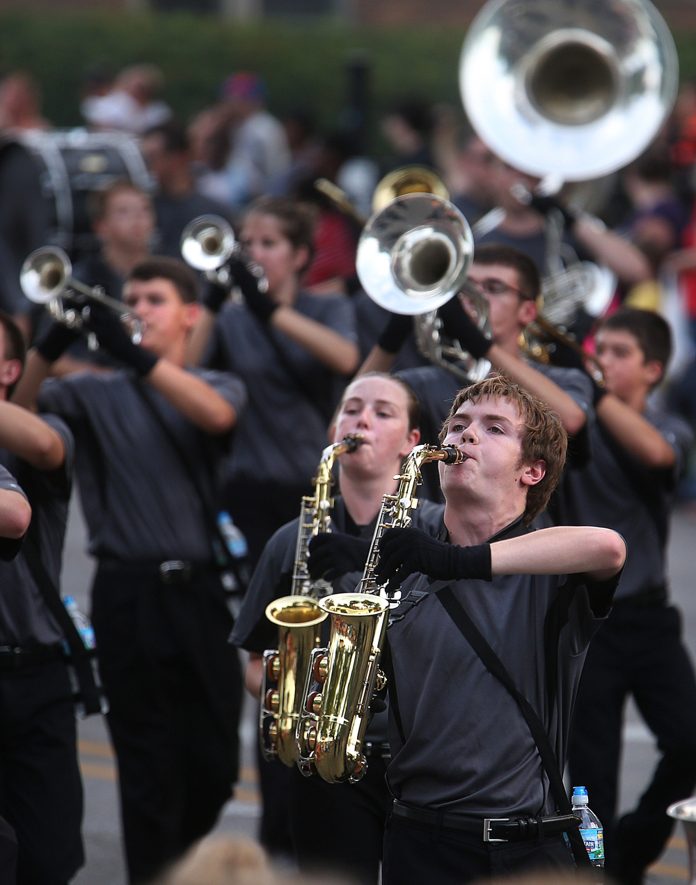 Musicians from Normal West High School Marching Band perform along the parade route. David Spencer/The State Journal-Register