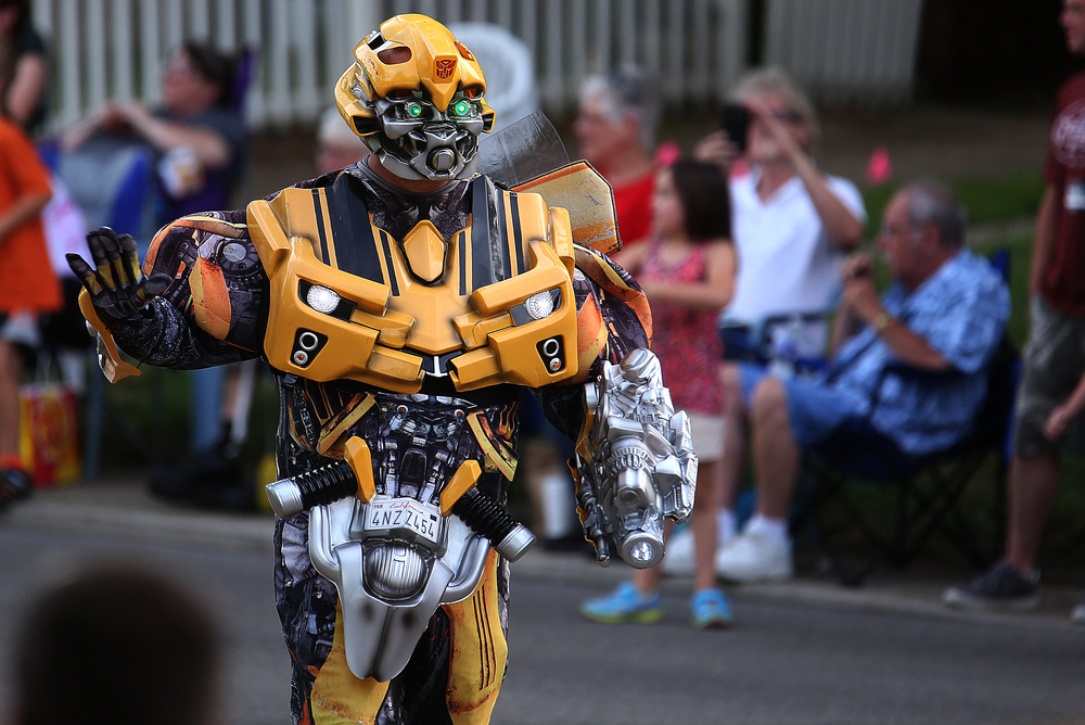 A Transformer walks along with represenatives from Powerlight Fest along the parade route. David Spencer/The State Journal-Register