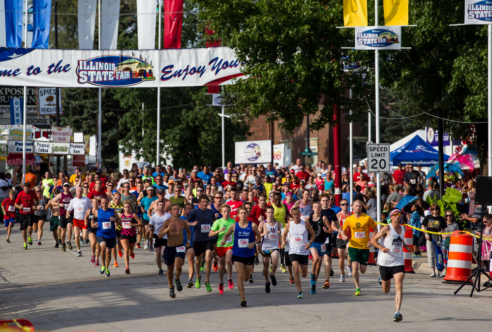 Jackson Johnson, right, leads the runners down Main Street for the 2015 Illinois State Fair Parade Run at the Illinois State Fairgrounds, Thursday, Aug. 13, 2015, in Springfield, Ill. Justin L. Fowler/The State Journal-Register