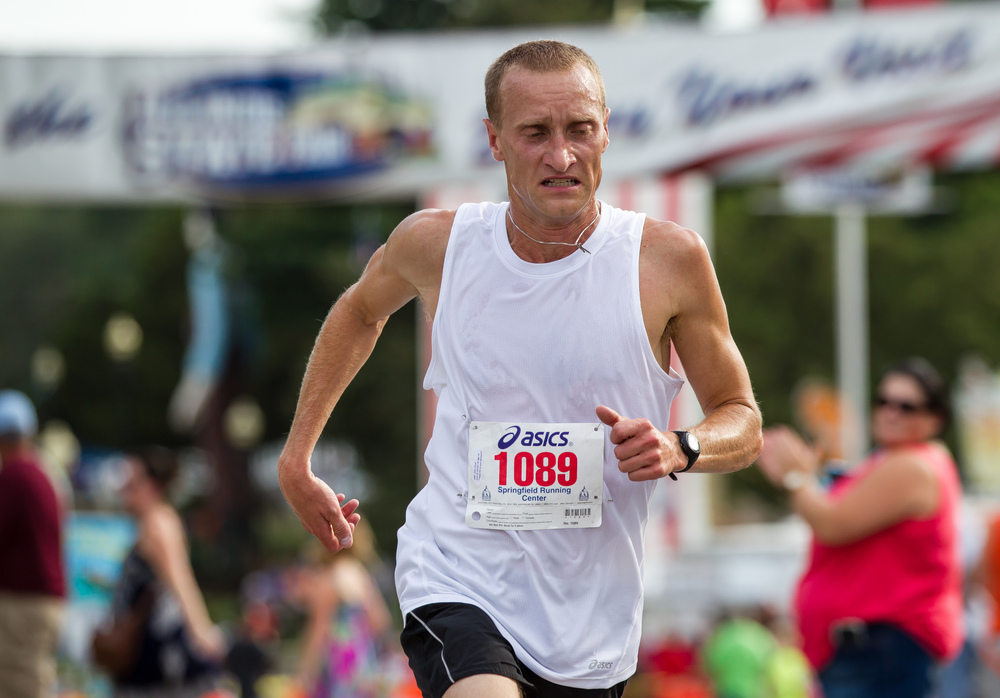 Bryan Glass takes home the victory in the Men's Division with a time of 9:52.2 during the Illinois State Fair Parade Run at the Illinois State Fairgrounds, Thursday, Aug. 13, 2015, in Springfield, Ill. Justin L. Fowler/The State Journal-Register