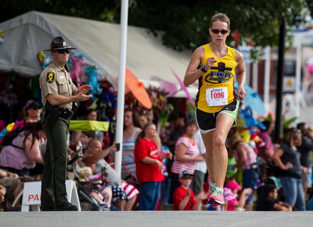 Joy Guardia takes home the victory in the Women's Division with a time of 12:07.9 in the Illinois State Fair Parade Run at the Illinois State Fairgrounds, Thursday, Aug. 13, 2015, in Springfield, Ill. Justin L. Fowler/The State Journal-Register