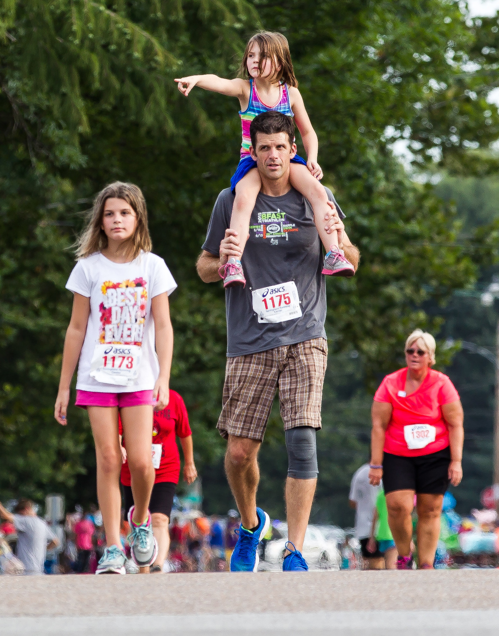 Josh Leinbach heads to the finish line with his daughter Lilianna, 5, atop his shoulders during the Illinois State Fair Parade Run at the Illinois State Fairgrounds, Thursday, Aug. 13, 2015, in Springfield, Ill. Justin L. Fowler/The State Journal-Register