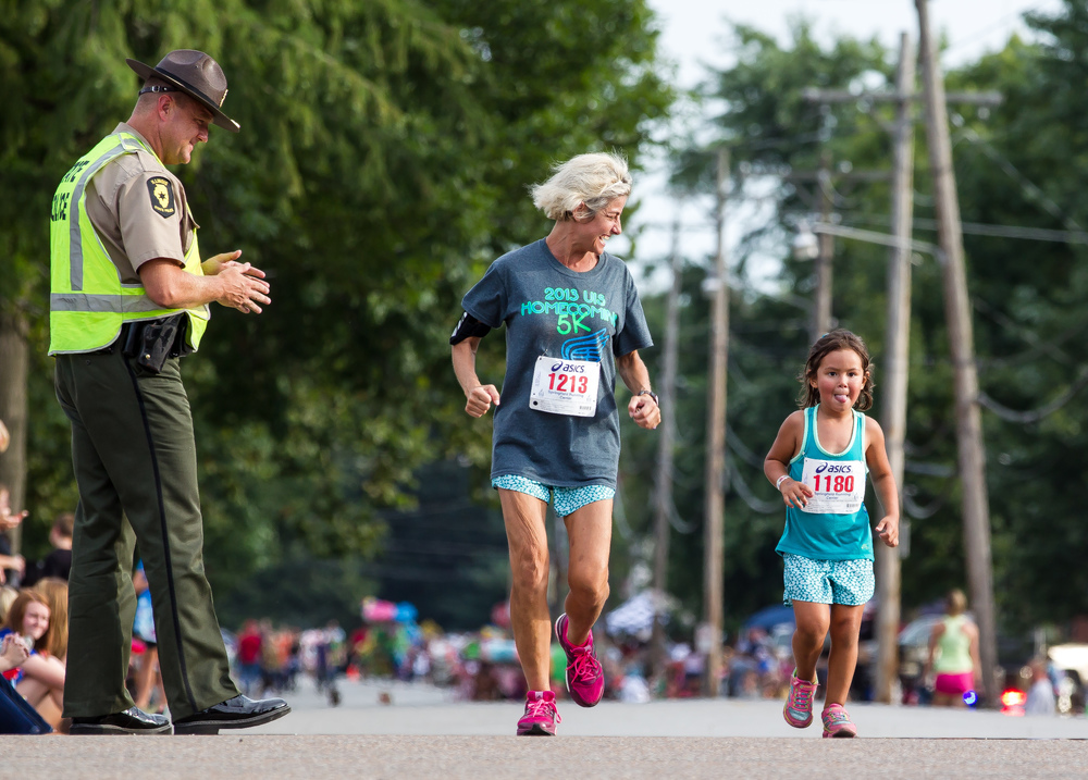 Mae Noll runs with Sophia Llosa, right, during the Illinois State Fair Parade Run at the Illinois State Fairgrounds, Thursday, Aug. 13, 2015, in Springfield, Ill. Justin L. Fowler/The State Journal-Register