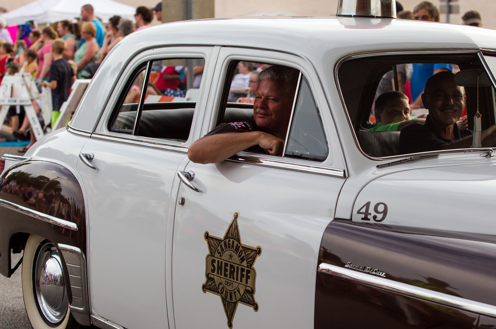 Sanagamon County Sheriff Wes Barr rides in an antique Plymouth Sheriff's car during the 2015 Illinois State Fair Twilight Parade at the Illinois State Fairgrounds, Thursday, Aug. 13, 2015, in Springfield, Ill. Justin L. Fowler/The State Journal-Register