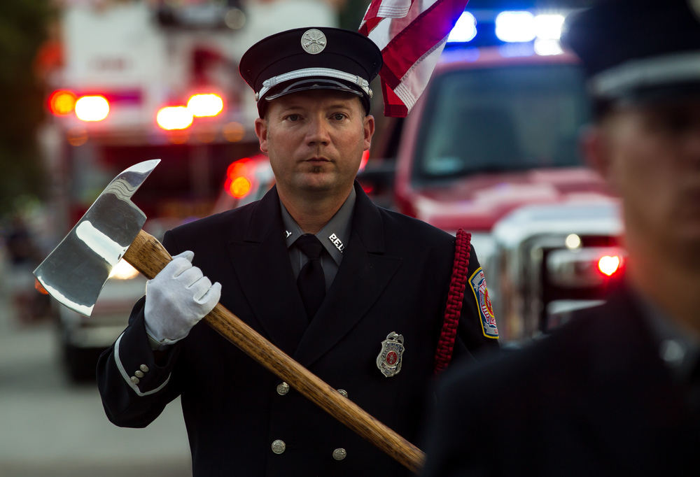 Members of the Pana Fire Dept. Honor Guard march through the Main Gate during the 2015 Illinois State Fair Twilight Parade at the Illinois State Fairgrounds, Thursday, Aug. 13, 2015, in Springfield, Ill. Justin L. Fowler/The State Journal-Register