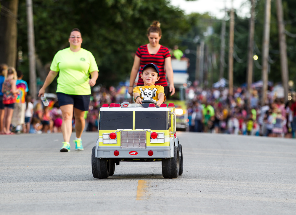 Jeremy Judd, 6, pilots his own fire engine as helps lead the Sherman Fire Dept. down North 11th Street during the 2015 Illinois State Fair Twilight Parade, Thursday, Aug. 13, 2015, in Springfield, Ill. Justin L. Fowler/The State Journal-Register