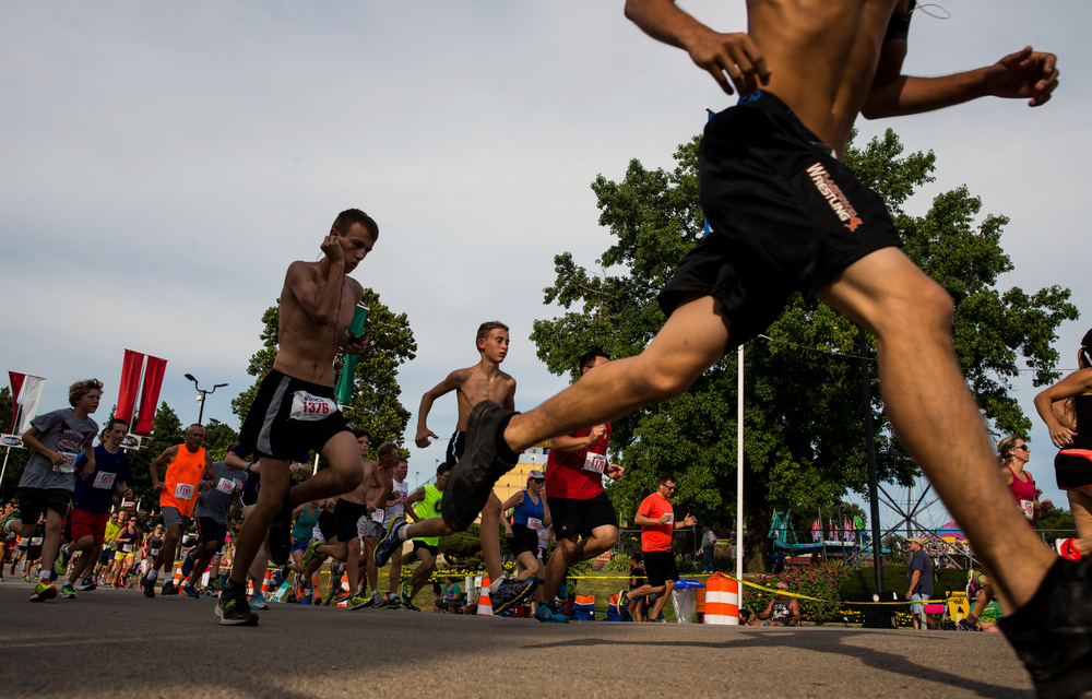 Runners make their way up Main Street as they head out of the fairgrounds for the Illinois State Fair Parade Run during the 2015 Illinois State Fair Twilight Parade at the Illinois State Fairgrounds, Thursday, Aug. 13, 2015, in Springfield, Ill. Justin L. Fowler/The State Journal-Register